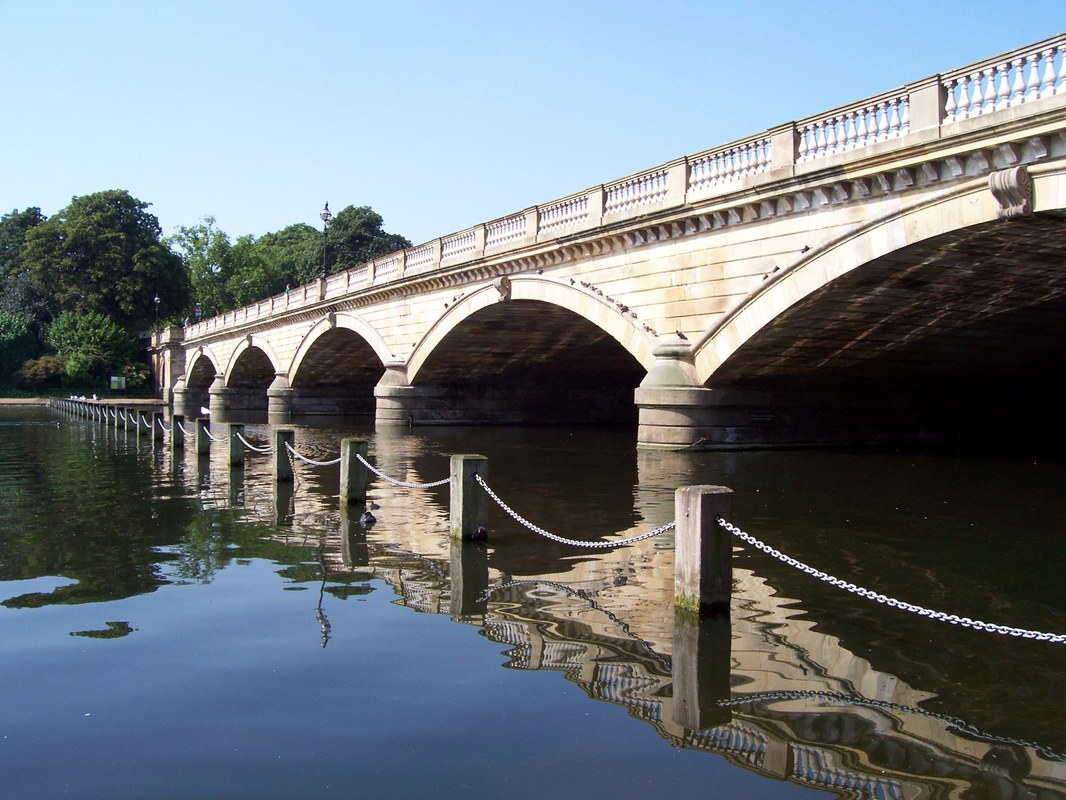 The Serpentine Bridge separating Kensington Gardens & Hyde Park, London, United Kingdom