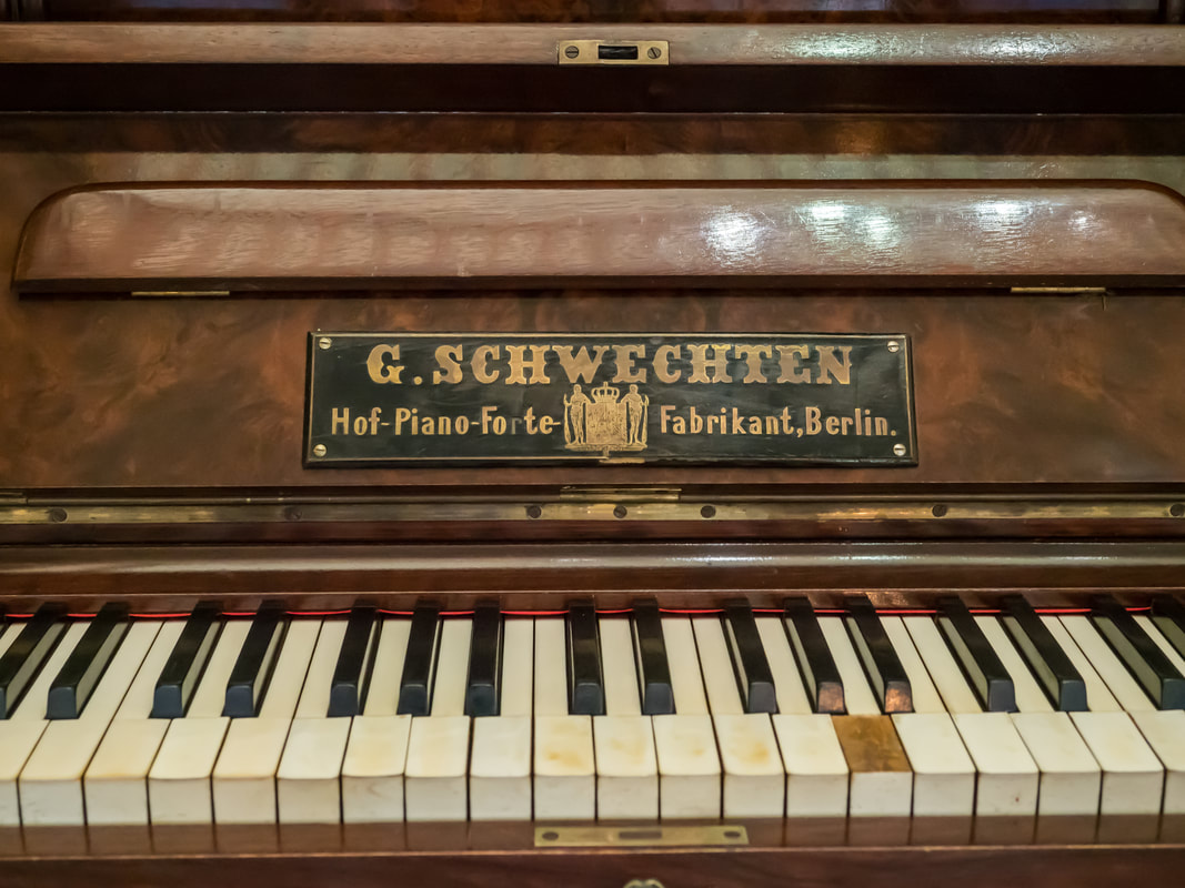 Vintage piano. Yellowed and broken piano keys. G Schwechten. Coolart Homestead, Mornington Peninsula, Australia.