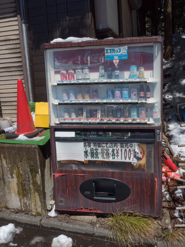 Street vending machine on the main street along the walking track. The walking track from the Lower Togakushi Shrine to the Middle Togakushi Shrine.