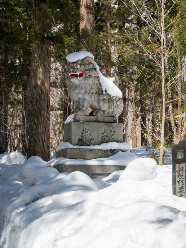 The Upper Togakushi Shrine, Mount Togakushi. Statue at the Red Rose Temple (also known as the Zuishinmon Gate). Nagano Prefecture, Japan.