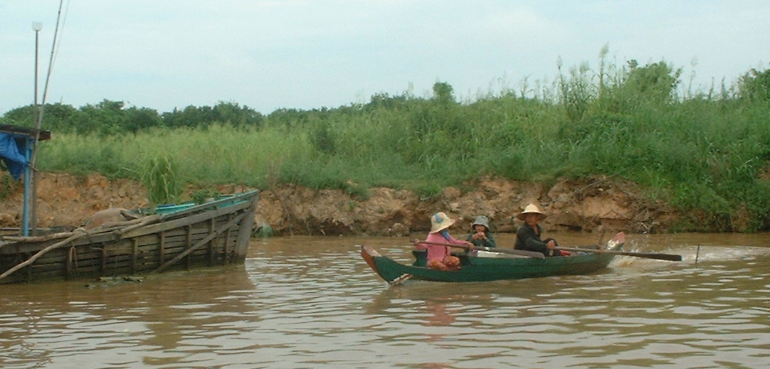 A family in a Boat on the Tonlé Sap Lake near Siem Reap in Cambodia