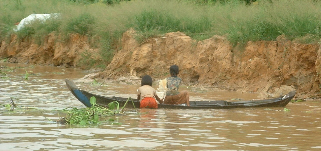 Children in a Boat on the Tonlé Sap Lake near Siem Reap in Cambodia