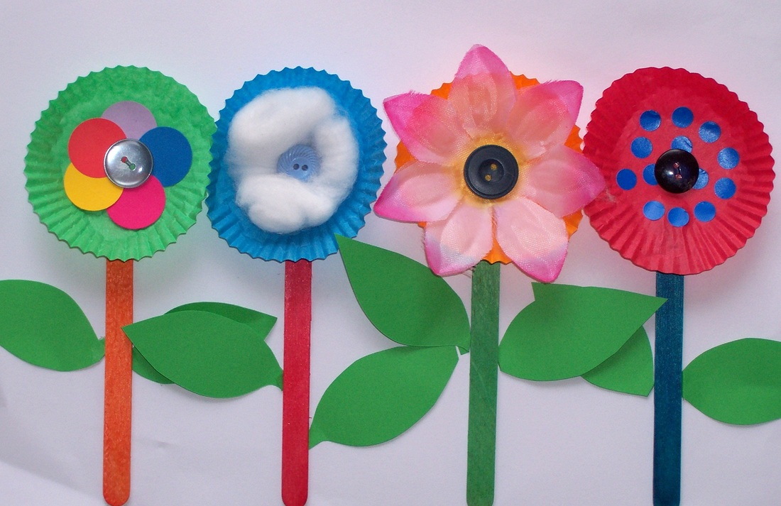 Free craft idea for children row of flowers using patty pans, pop sticks, buttons and more