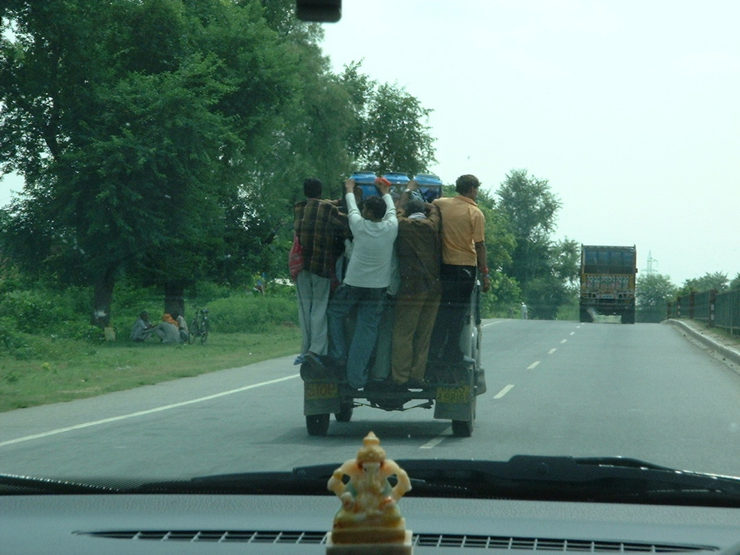 India, roads, people on vehicles