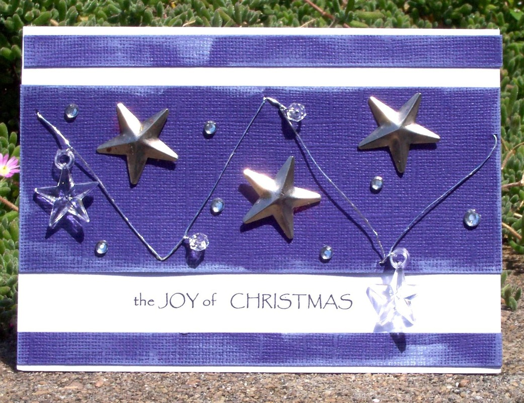 Instructions on how to make this Christmas card with stars and wording the joy of christmas