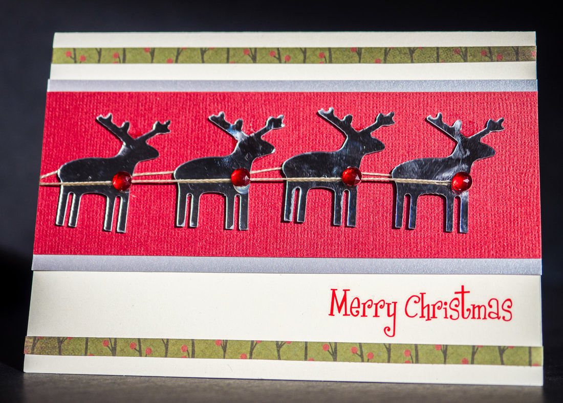 DIY craft Christmas card with reindeer embellisments.
