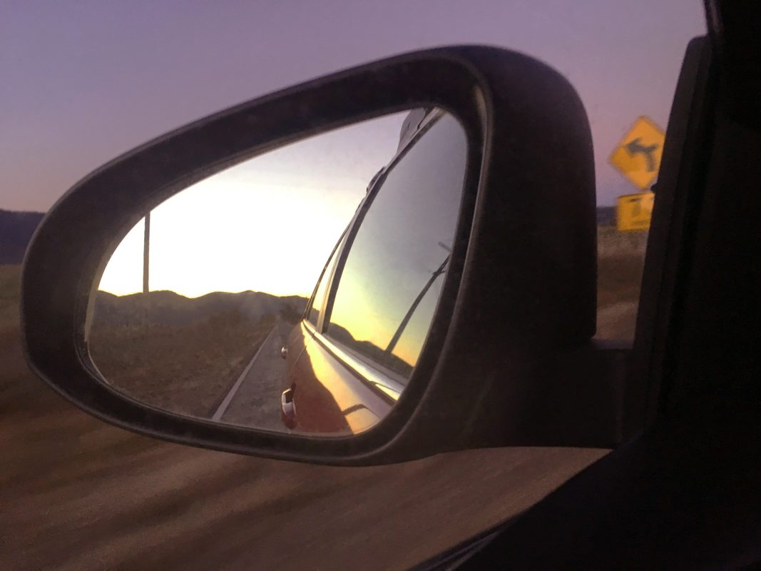 Photo taken in the rear view mirror of the car.