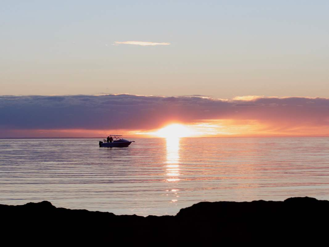 Boat on the water at sunset, Mount Eliza, Mornington Peninsula, Victoria, Australia